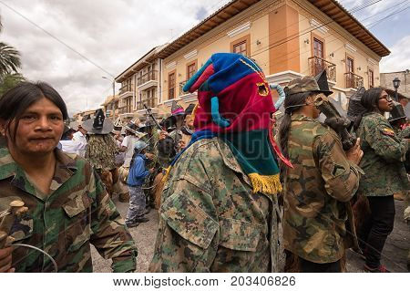 July 24 2017 Cotacachi Ecuador: indigenous kichwa men on the street at Inti Raymi celebration