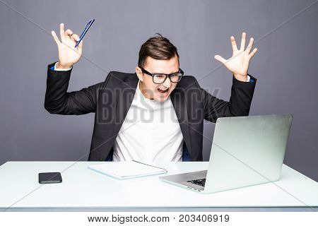 Angry Senior Businessman Sitting At His Desk And Screaming. Angry Businessman With Too Much Work In