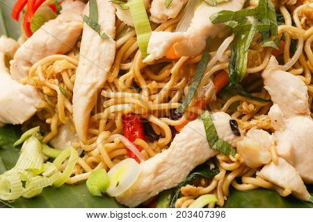 Close up view of fried noodles with vegetables