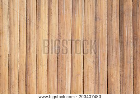 Wooden plank table top view. Warm beige photo texture. Obsolete wood table board. Rustic decor wallpaper backdrop. Vintage lumber surface grit. Colored bamboo plank board. Natural timber texture
