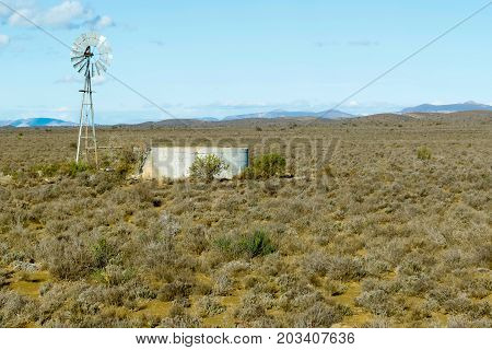 Windmill In The Fields Of Central Karoo