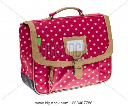 Fancy red schoolbag with white dots isolated against a white background.