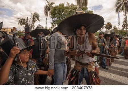 July 24 2017 Cotacachi Ecuador: indigenous man holding a gun at Inti Raymi celebration
