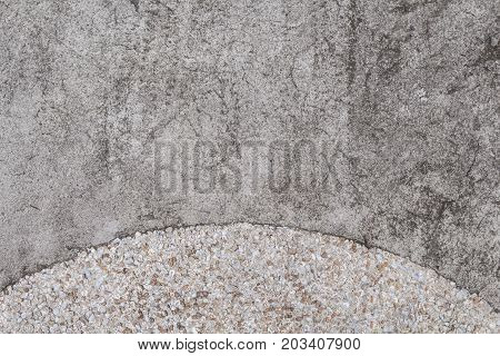 Rough concrete texture with pebbles. Grey asphalt road top view photo. Distressed and obsolete background texture. Natural concrete floor top view. Rustic asphalt road surface. Grungy grit backdrop