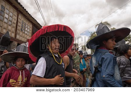 July 24 2017 Cotacachi Ecuador: indigenous kichwa men wearing large sombreros on the street at Inti Raymi celebration