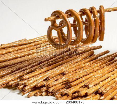 closeup of some salt sticks and pretzels in light back