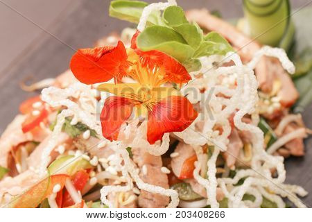 Close up view of rice noodles with vegetables