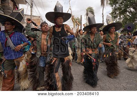 July 24 2017 Cotacachi Ecuador: indigenous kichwa men wearing a traditional furry chaps on the street at Inti Raymi celebration