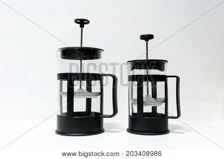 Two Different Sizes Of French Press Coffee Maker Isolated On White