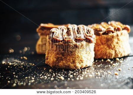 Cake With Sweet Boiled Condensed Milk On Dark Wooden Table