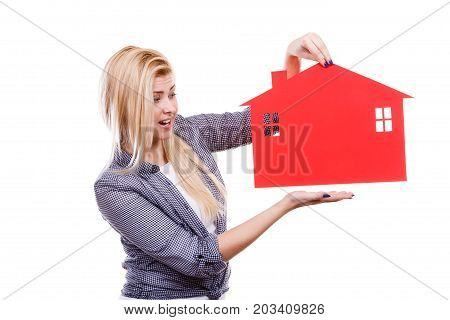 Ownership and property concept. Happy woman holding red paper house moving to new home.