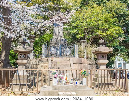 HAKONE, JAPAN - JULY 02, 2017: Close up of a stoned statue in hanami park during cherry blossom season in Kyoto, Japan.