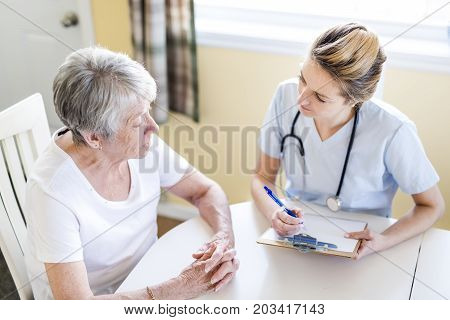A Senior woman with her caregiver at home