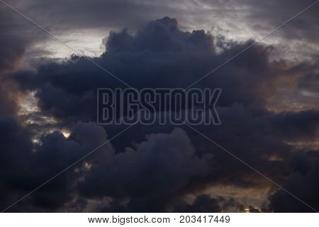 Large cumulus clouds before a storm natural background during sunset over the sea water Island Mauritius
