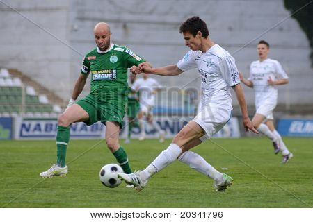 KAPOSVAR, HUNGARY - APRIL 27: Denes Rosa (in green) in action at a Hungarian National Championship soccer game - Kaposvar vs Ferencvaros on April 27, 2011 in Kaposvar, Hungary.