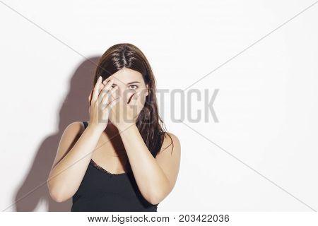 Pretty Girl Hiding Behind Her Hands.