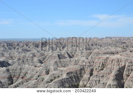 stunning layered rock formations, steep canyons and towering spires make up the landscape in badlands national park in south dakota