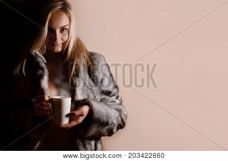 Girl In Warm Dress With Coffee Cup