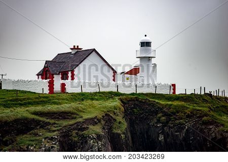View of The lighthouse on a cliff in Dingle, Ireland