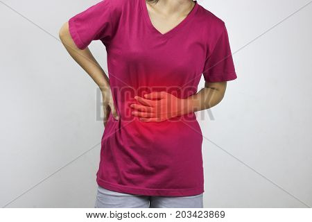 women has stomachache and pain in pink t-shirt