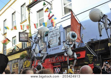 Shop Street, Galway, Ireland July , Art Festival 2017, I-puppets , Walking In The Crowd