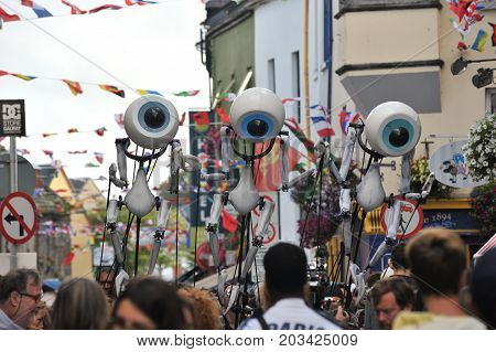 Shop Street, Galway, Ireland July , Art Festival 2017, I-puppets , 3 Puppets Walking Up The Street I