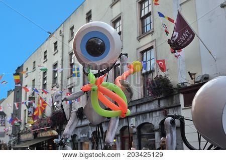 Shop Street, Galway, Ireland July , Art Festival 2017, I-puppets , A Puppet With A Balloon In The Ha