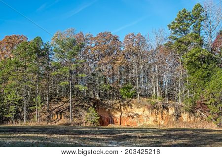 Red clay hills on a fall day in north Mississippi.