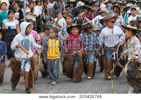 June 24 2017 Cotacachi Ecuador: young kichwa indigenous children participating at the summer solstice parade