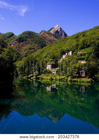 Mountain Lake With Small Hamlet And Historic Church