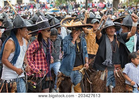 June 24 2017 Cotacachi Ecuador: indigenous people dancing in the street during summer solstice celebrations