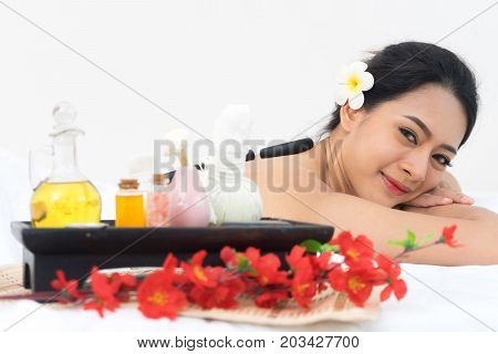 Young beautiful caucasion woman lying on white bed in spa salon shop. healthy care concept. relaxation girl.