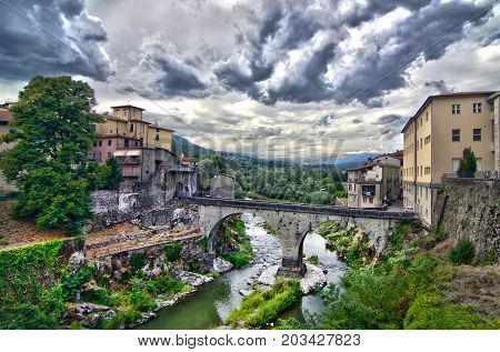 Stone Bridge Connects Two Sides Of An Ancient Village Under Cloudy Sky