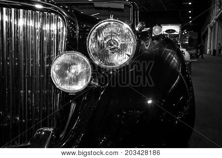 MAASTRICHT NETHERLANDS - JANUARY 08 2015: Detail of the oldtimer Jaguar Mark V Saloon 1949. Black and white. International Exhibition InterClassics & Topmobiel 2015