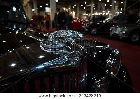 MAASTRICHT NETHERLANDS - JANUARY 08 2015: Hood ornament (Jaguar in the jump) of the Jaguar Mark V Saloon 1949. International Exhibition InterClassics & Topmobiel 2015