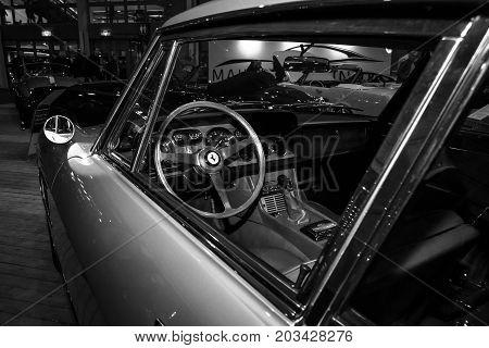 MAASTRICHT NETHERLANDS - JANUARY 08 2015: The cockpit of a sports car Ferrari 330 GT 2+2 Series II. Black and white. International Exhibition InterClassics & Topmobiel 2015