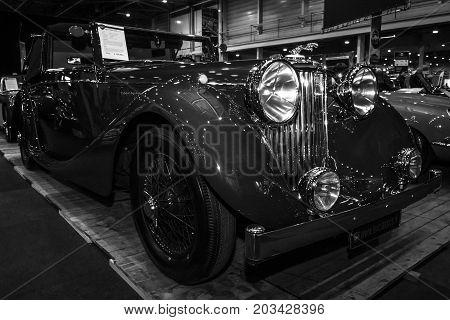 MAASTRICHT NETHERLANDS - JANUARY 08 2015: Oldtimer Jaguar Mark IV DHC. Black and white. International Exhibition InterClassics & Topmobiel 2015