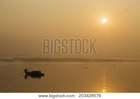 Golden sunrise on the river Ganges in Varanasi India