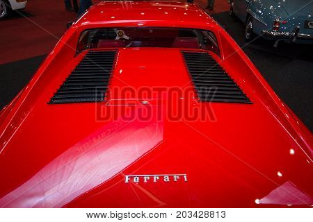 MAASTRICHT NETHERLANDS - JANUARY 08 2015: The engine compartment of a sports car Ferrari 308 GTB. Rear view. International Exhibition InterClassics & Topmobiel 2015