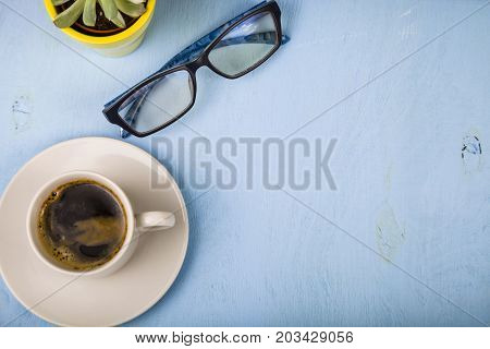 Сup Of Coffee, Glasses And A Plant