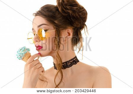 beautiful sexy brunette woman in round glasses with ice cream