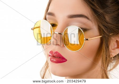 beautiful woman in yellow round glasses close-up