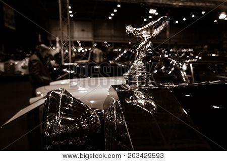 MAASTRICHT NETHERLANDS - JANUARY 08 2015: Hood ornament (Spirit of Ecstasy) of a Rolls-Royce 20/25 Sedanca de Ville by Gurney Nutting. Stylization. Sepia. International Exhibition InterClassics & Topmobiel 2015