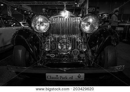 MAASTRICHT NETHERLANDS - JANUARY 08 2015: Luxury car Rolls-Royce 20/25 Sedanca de Ville by Gurney Nutting. Black and white. International Exhibition InterClassics & Topmobiel 2015