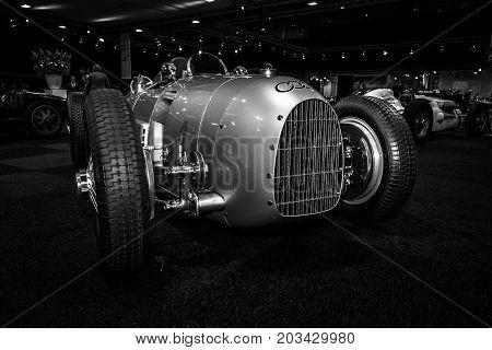 MAASTRICHT NETHERLANDS - JANUARY 08 2015: The Grand Prix racing car Auto Union Type A 1934. Black and white. International Exhibition InterClassics & Topmobiel 2015