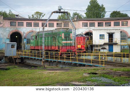 SHARYA, RUSSIA - SEPTEMBER 04, 2017: Shunting locomotive ChME2 on the turn circle of the locomotive depot