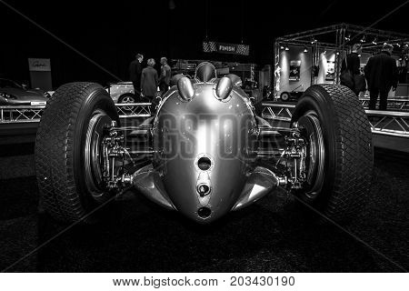 MAASTRICHT NETHERLANDS - JANUARY 08 2015: The Grand Prix racing car Auto Union Type A 1934. Rear view. Black and white. International Exhibition InterClassics & Topmobiel 2015