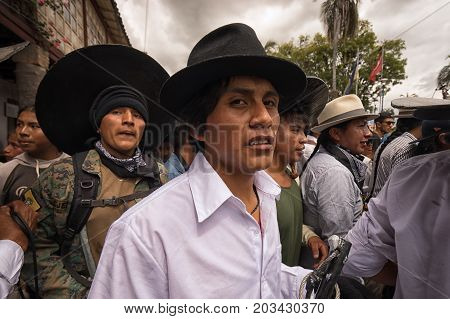 June 24 2017 Cotacachi Ecuador: closeup of indigenous kichwa men participating in a parade at summer solstice