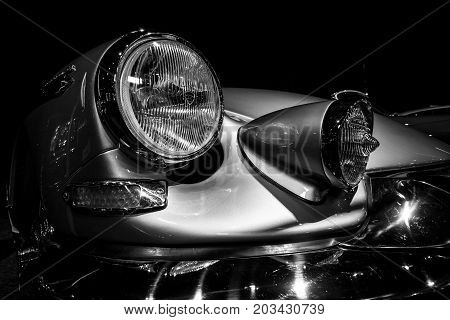 MAASTRICHT NETHERLANDS - JANUARY 08 2015: Headlamp Citroen DS19 Chapron Concorde 64. Black and white. International Exhibition InterClassics & Topmobiel 2015