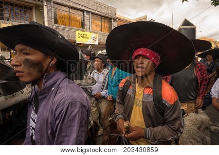 June 24 2017 Cotacachi Ecuador: closeup of indigenous kichwa men participating at an Inti Raymi parade at summer solstice
